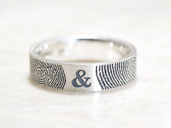 You & Me Fingerprint wedding bands in sterling silver by Brent&Jess