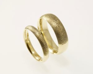 Custom Brent&Jess yellow gold fingerprint rings
